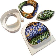 Rebecca Geoffrey's Jelly roll mokume gane pendants/brooches in silver bezals