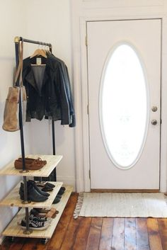 When I sawthis industrial storage rackfrom Urban Outfitters I knew it was exactly what we needed for our entryway. It's got the simple, masculine, industrial look that I'm always attracted to, and it's the perfect size to store our favorite shoes and jackets. But, I couldn't see spending