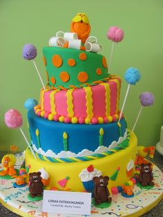 My first topsy turvy cake. Lots of fun making this cake. I made the trees out of cotton candy :) -- the little guys were fun to make. TFL :)
