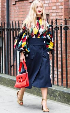Kate Foleyteamed her vibrant shirting with a red lip and matching J.W. Anderson Pierce bag.