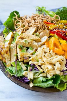 This recipe for Chinese chicken salad is loaded with chicken, veggies, won tons and mandarin oranges, all tossed in a sesame ginger dressing.