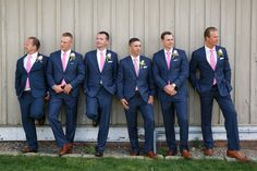 Preppy groomsmen in navy suits and pink ties {Candace Jeffery Photography}