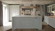 {Sims Hilditch interior design and Neptune handmade kitchens - the central island is painted in a shade called 'Mist' from the Neptune paint range which is gorgeous!}  countetops - wood and marble.