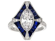Bella Luce (R) 3.86ctw Sapphire And White Diamond Simulants Rhodium Over Sterling Silver Ring