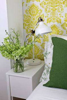 The bed is flanked by two little white bedside tables with lamps, making a cozy nook to retire for the night.