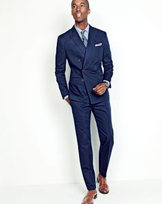 J.Crew men's Ludlow double-breasted suit jacket in Italian chino, Secret Wash shirt in heritage blue stripe, Ludlow pant in Italian chino, English silk-linen tie in foulard, tipped Italian linen pocket square, Mougin & Piquard™ chronovintage watch and Ludlow penny loafers.