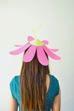 Flower party hats http://ohhappyday.com/2014/05/paper-flower-party-hats/
