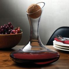 Formed from lead-free crystal glass into a sensual, curvaceous silhouette, this NUDE Oxygen wine decanter is crowned with a circular cork stopper, which offers warmth and contrast in its modern mix of materials. Wine Carafe, Pinot Noir Wine, Recycled Wine Bottles, Wine Reviews, Expensive Wine, Cork Stoppers, Cheap Wine, Leaded Glass, Wine Drinks