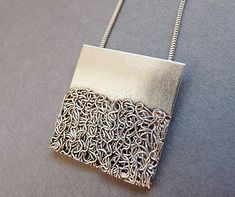 This modern and unique pendant is completely handmade in sterling silver 925 and 99.9 fine silver wire. It has been textured, partially oxidized