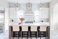 Three Darlana Medium Lanterns make a statement in a white transitional kitchen boasting multiple patterns and dimension.
