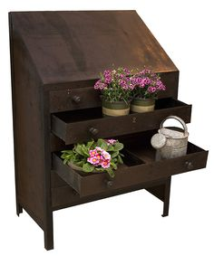 Take, for example an antique industrial cabinet like this one, and turn it into a flower box. Or add dirt and drainage and make it a planter.