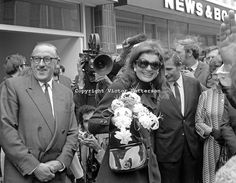 Jackie Kennedy Onassis during a visit to Belfast, N Ireland, UK. She was accompanying her husband, Greek shipping magnate, Aristotle Onassis, to the Harland & Wolff shipyard where he is a 25% shareholder. Jackie is in Queen Street, Belfast where she and husband were entertained to a buffet lunch in the Harland & Wolff Social Club.  197009050347b<br /> <br /> Copyright Image from Victor Patterson, 54 Dorchester Park, Belfast, UK, BT9 6RJ<br /> <br /> t: +44 28 90661296<br /> m: +44 7802…