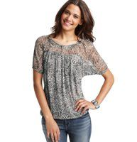 Animal Print Knit Woven Top - We combined a knit bodice and woven yoke to create this casually lovely top, in an oh-so-chic tribal print. Scoop neck. Short sleeves. Shirred at neckline. Gathered above yoke. Keyhole detail at back neck with button closure. Gathered elasticized hem.