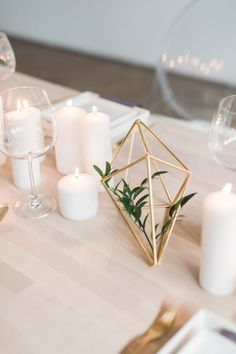 Modern brass geometric table decor: http://www.stylemepretty.com/canada-weddings/ontario/toronto/2017/01/20/minimal-white-wedding-inspiration-for-winter-lovers/ Photography: Rhythm -http://www.rhythm-photography.com/