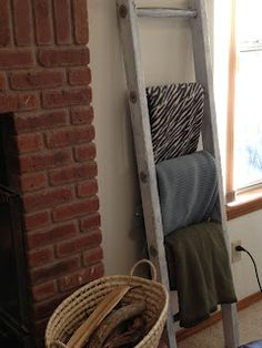 Use a ladder to hold extra blankets in the living room to cozy up with in winter. Keeps it looking neat and tidy too