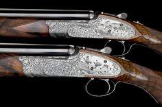 A pair of Holland & Holland shotguns, displaying some highly-intricate engraving