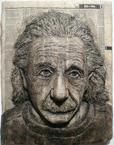 A phone book carved Einstein / It's All Relative, by Alex Queral