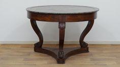 Empire tafel mahonie met rond marmeren blad, rustend op gebogen poten versierd met mascarons van schapen, circa 1820, h. 76, diam. 112