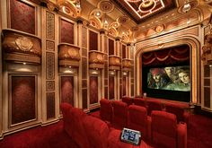An unbelievable all regal red home theatre with private box seating facades to emulate a 30's style theatre! Very impressive!! | Caption by Jenn Brown