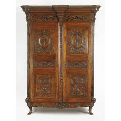 A Louis XVI carved walnut and mahogany armoire<br>late 18th century, possibly Belgium | lot | Sotheby's