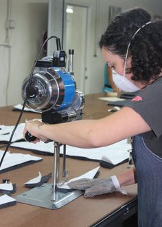 Brenna Lane of Detroit Denim, cutting fabric with the knife.