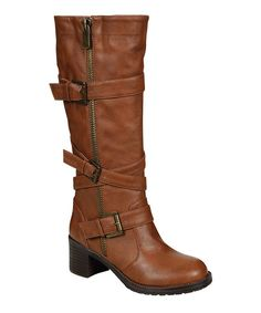 These moto boots were made for walking thanks to a series of secured buckle straps along the shaft and a handy-dandy side zipper, while biker embellishments edge up this fashionable footwear.0.25'' heel17.25'' shaft15'' circumferenceZipper closure