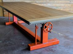 Our Crank table in Orange with a worn oak top. Built by Vintage Industrial in Phoenix!