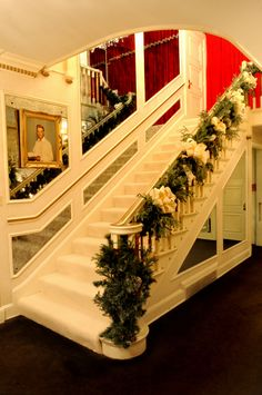Stairway decorated for Christmas at Elvis Presley's Graceland. I want to go here because I love Elvis and it would be a good experience.