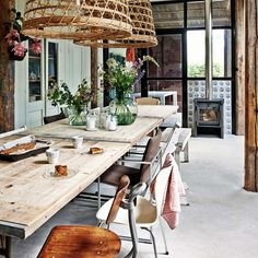Dining rooms don't have to be formal or stuffy. We're all about a boho chic dining space, too! Check out these 40 dining rooms that master boho interior design. For more dining room design ideas, go to Domino! Küchen Design, House Design, Interior Design, Blog Design, Room Interior, Design Trends, Rustic Table And Chairs, Table Lamps, Bamboo Pendant Light