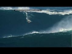 Garrett McNamara surfs a record 90-foot wave off Portugal.  What a wonderful guy....he always helps with Surfers Healing!