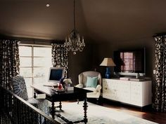 Home office space with brown walls.