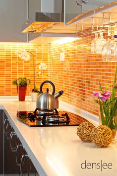 Beautiful use of orange tile as a counter top backsplash in the kitchen.  Just stunning!  #ppgorange