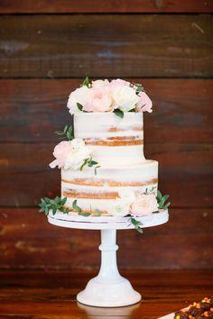 naked wedding cake blush and white cake flowers greenery and flowers on cake