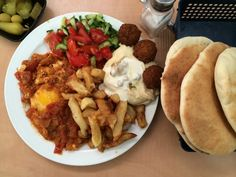 Miro's Shakshouka   Kosher Scoop Israeli Breakfast, Red Tomato, Spicy Sauce, Easy Diets, Fries In The Oven, Falafel, Stuffed Green Peppers, Cravings, Kitchens
