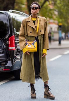 ELLE accessories editor Donna Wallace wearing a layered trench coat with yellow Louis Vuitton cross-body bag