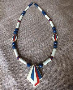 Large Bohemian Art Deco Beaded Necklace. $12.00, via Etsy. festival style summer red white blue 70s