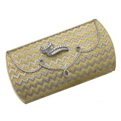 TWO COLOUR GOLD AND DIAMOND EVENING BAG, BULGARI, CIRCA 1965 The hinged bag of modified rectangular form, decorated with a stylised swirl motif set with brilliant-cut and baguette diamonds, the clasp of scalloped design set with brilliant-cut stones, opening to reveal a mirror