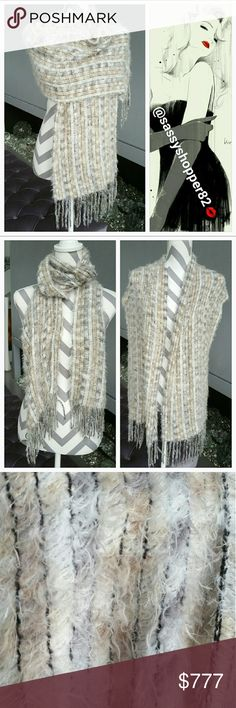 Beautifully soft scarf Beautiful and super soft this sophisticated scarf is MUST HAVE for you fall/winter wardrobe. Complimentary color pallete of cream, light grays and tan make this scarf just stunning.   Worn only one No tags Accessories Scarves & Wraps