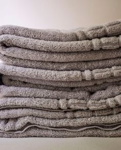 ToWeL CaRe ___Skip the Fabric Softener for Towels, It Makes Them Less Absorbent. Avoid using chlorine bleach, which can be damaging to fibers. Wash towels on their own (so they don't transfer lint to clothes) in warm or hot water, dry them on medium heat, & remove & fold them immediately