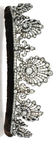 A LATE 19TH CENTURY DIAMOND TIARA NECKLACE. Composed of a series of five graduated openwork shell design panels, each with an old-cut diamond collet centre to a radiating diamond line surround, with similarly-set stylised fleur-de-lys motif spacers, raised on a diamond line, mounted in silver and gold, circa 1880, with gold mesh backchain and brooch fitting, original fitted case, two diamonds deficient.