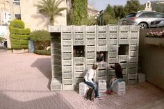 LAU architecture students assemble emergency shelter with plastic crates + ties