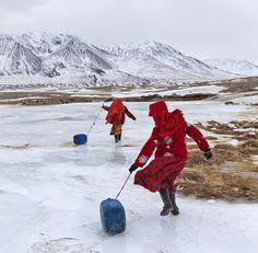 #Kyrgyz girls slide plastic jugs back to their family's camp after fetching water in Wakhan, #Afghanistan  Photo by @paleyphoto