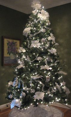 Silver and White and Poinsettia Tree. My 2013 tree.