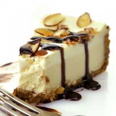 A Delicious recipe for dark chocolate drizzled Cheesecake with toasted almonds.