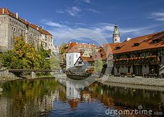 Picturesque autumn. View of Cesky Krumlov and the bridge.