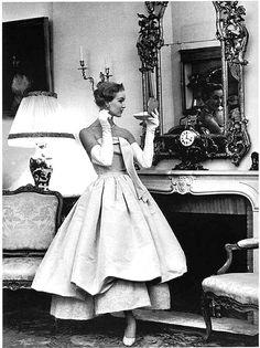 Dorian Leigh in evening gown with fur collar by Balenciaga, 1953.