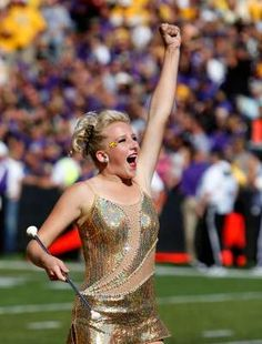 Action shots don't always mean the baton is twirling... the Feature Twirler is a fan just like everyone else!
