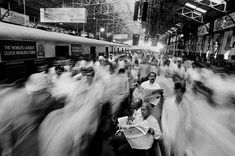 Raghu Rai.  Local commuters at Church Gate railway station. Mumbai. 1995.