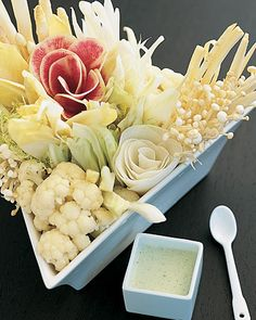 Sides!  White Crudites    A jubilant symphony of pale crudites, including cauliflower, white asparagus, endive, and celery, is arranged in a triangular dish. This is gorgeous!  #saveur #dinnerparty