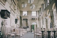 A contemporary wedding at an unusual wedding venue Aynhoe Park with taxidermy decor and dress by Emily Garrod